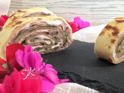 Rotolo di crespelle al parmigiano con mortadella e zucchine